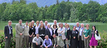 Group of scholars at UJEI meeting, Salzburg, with Prof. Wynn kneeling (far right)