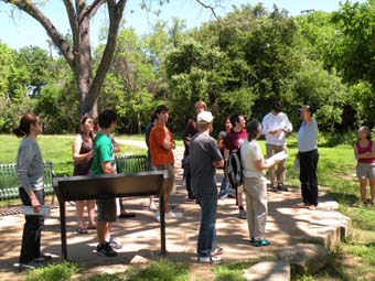 Geography students and faculty examine canals