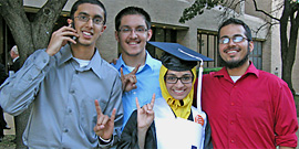 Graduate Fatima Bhuriwala with friends who share her Longhorn pride and talk on the phone at the same time