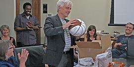 Graduate Advisor Jim Sidbury receives his appreciation-goodbye gift