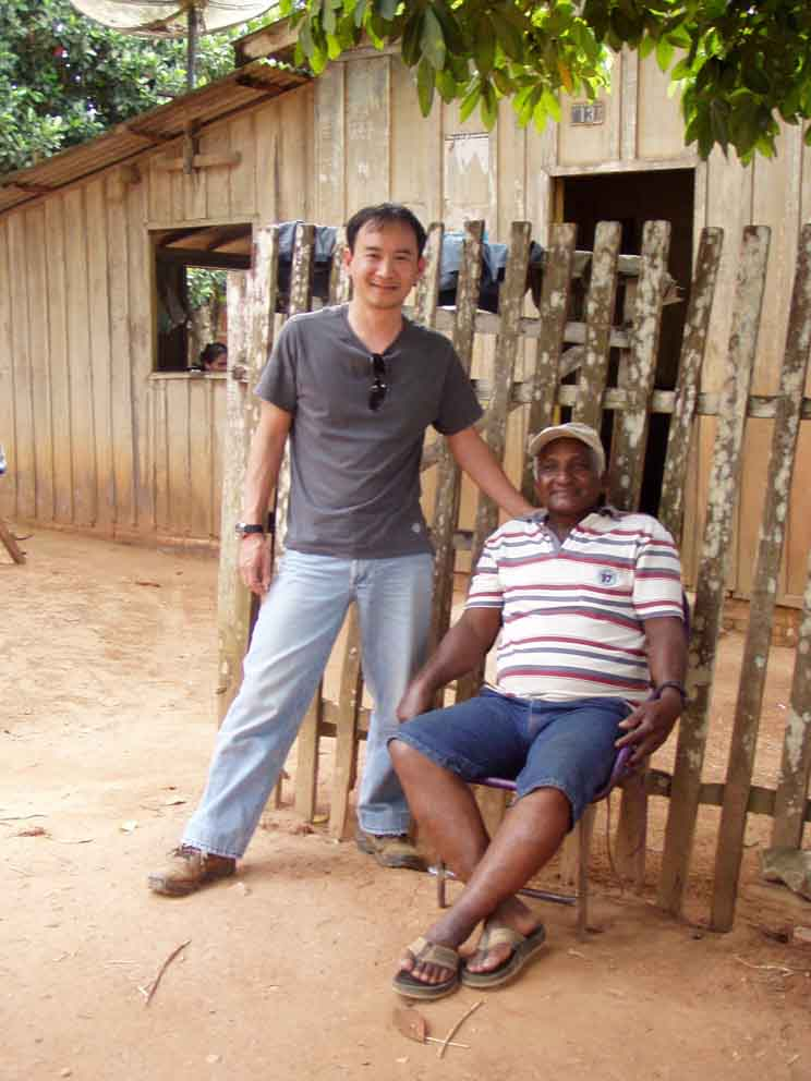 Dr. Arima (left) greeting a local resident in the Amazon