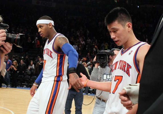 Photo credit: Jim McIsaac | Jeremy Lin, right, and Carmelo Anthony, left, celebrate after defeating the New Jersey Nets. (Feb. 4, 2012)