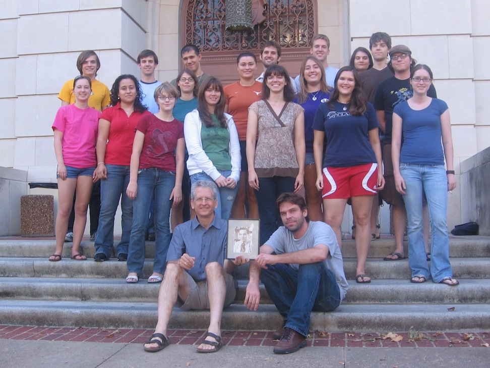 Intensive Greek, Class of 2009, with Prof. Tom Palaima and Assistant Instructor James Patterson, holding Prof. Gareth Morgan's portrait.