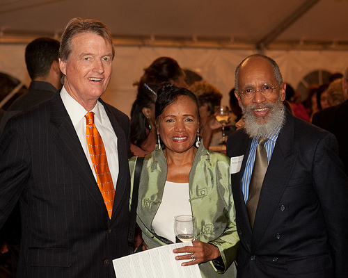 Dr. King Davis (far right) with President Bill Powers and Rev. Dr. Victoria Pratt-Davis at an event at the Carver Museum and Cultural Center last December.