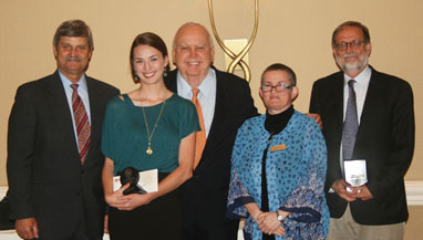 Co-op Mitchell Award presentation. From left: Provost Steven Leslie, Jillian Owens, University Co-op President George Mitchell, Dean Esther Raizen, Professor Thomas Tweed