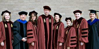 History Ph.D. graduates (l-r): Erica Whittington, Aragorn Storm Miller, Amber Abbas, Chris Dietrich, Lisa Lacy, Renata Keller, Jesse Cromwell, Christelle Le Faucheur