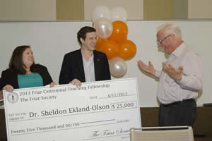 Students present the Friar award to Dr. Sheldon Ekland-Olson in class. Photo by Marsha Miller.