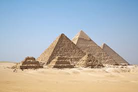 Proximal Menkaure pyramid and three little ones next to it, fondly referred to as