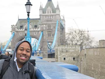 Erick walking across Tower Bridge in London, England, the first stop on his trip around the world