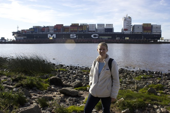 Lauren stands at the edge of the River Plate in the Reserva Ecológica as a cargo ship enters the Port of Buenos Aires