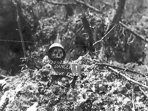 Front line warning sign using a Japanese soldier's skull on Peleliu. (Photo: Public Domain)