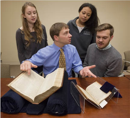 Dr. Elon Lang, center, with students left to right: Lily Pipkin, Haley Williams and Kenneth WIlliams.