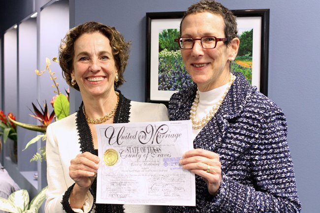 Suzanne Bryant (left) and Sarah Goodfriend hold up their marriage license after a press conference on February 18. They were the first same-sex couple to marry in Texas.