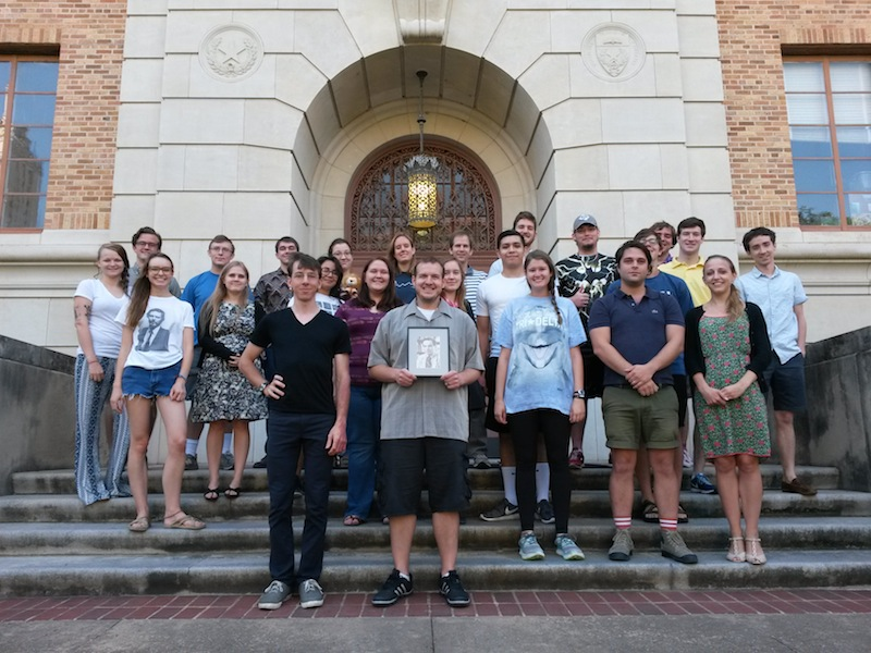Instructors and students on the steps of Waggener Hall