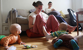 A mother cares for her twins while on nationally-mandated maternity leave in Stockholm, Sweden.