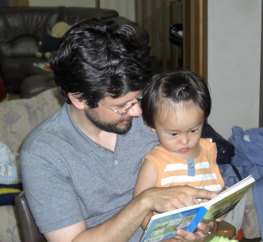 PhD Candidate Benjamin Cox reads with child