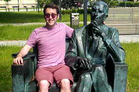 Zachary Stone, Normandy Scholar Alum, at the Jan Karski statue in Poland during NSP study abroad