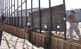 U.S. Air Force airmen install a fence along the U.S.-Mexico border east of San Luis, Ariz., on Oct. 3, 2006. Source: DOD