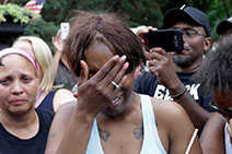 Diamond Reynolds, the girlfriend of Philando Castile of St. Paul, cries outside the governor's residence in St. Paul, Minn. Photo: Jim Mone