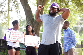 Houston spoken word artist Willy Showtime performs at a memorial for Sandra Bland on the anniversary of her arrest in Prairie View, Texas. Photo: Patrick Michels