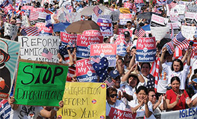 (March 21st, 2010) Roughly 200,000 immigrants, SEIU members, union members and activists rallied on the National Mall to demand Congress pass immigration reform. Photo by Lloyd Wolf