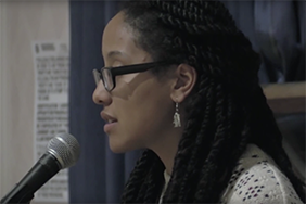 Ariana Brown performing at the 2014 College Unions Poetry Slam semifinals at UT-Austin
