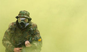 U.S. soldier practices donning his gas mask during a field exercise. Photo by U.S. gov.