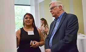 Gabryella Desporte tells Dean Randy Diehl about her research.