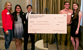 A check ceremony of a previous Philanthropy: The Power of Giving class.