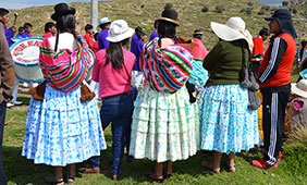 Women in polleras gather to watch a carnaval parade in Acora, Puno District. Photo: Angela Tapia Arce.