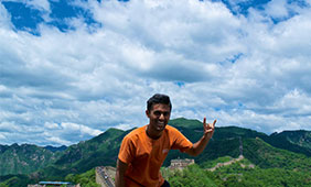 Shantanu Banerjee shows a Hook 'Em in front of the Great Wall of China.