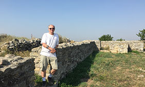 Orr stands amongst Histria ruins in Romania.