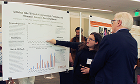 Student researcher Ariana Azimi explains her project to Dean Randy Diehl.