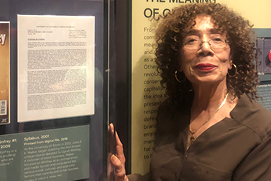 "Professor Walker with her syllabus, at the NMAAHC's ""Oprah Winfrey and American Culture"" exhibit opening"