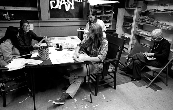 "Photo by Alan Pogue. Women of The Rag and ""Mother Smith"" (right) work on layout, Feb. 1974."