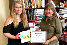 Haley Price, pictured with artwork, receives award certificate from Dr. Jones. Photo by Martha Gonzalez.