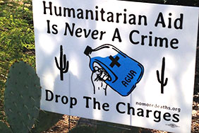 Yard signs in Tucson in support of volunteers. Photo Credit: No More Deaths – http://forms.nomoredeaths.org/trial-date-set-for-the-cabeza-prieta-nine/