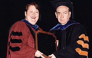 Dr. Zigler receiving the 2000 UT Graduate School Distinguished Alumnus Award from Vice-Provost and Dean of the Graduate School Dr. Teresa Sullivan