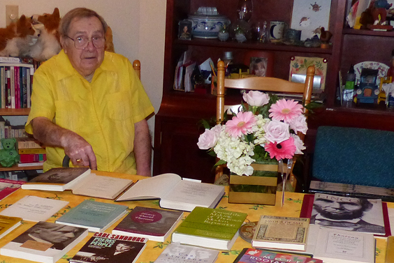 Photo: Dr. George Hendrick on his 90th birthday last March, shown with some of the many book-length publications he wrote, co-wrote, edited or co-edited.