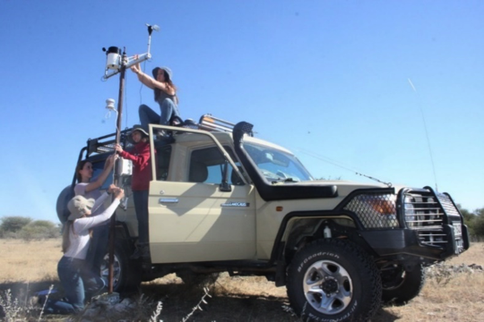 Students installing a weather station in the Kalahari Desert field site